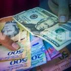El dólar puso a la economía venezolana entre dos aguas